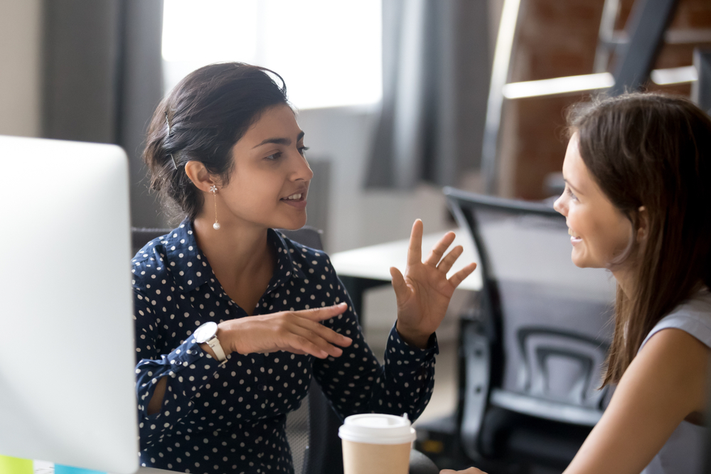 employee discussing with colleague
